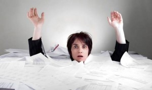 WomanDrowning in Paperwork employers-rx dot com